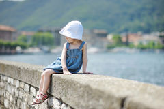 Child sitting on a stone parapet Royalty Free Stock Images