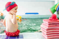 Child sitting at swimming pool Royalty Free Stock Image