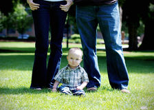 Child Sitting Under Parents - Vertical Royalty Free Stock Photos