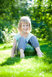 Child sitting on watermelon Stock Photo