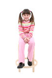 Child Sitting On a Wooden Stool royalty free stock photo