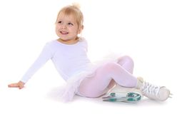 Child skater sitting on the floor in sportswear Royalty Free Stock Photos