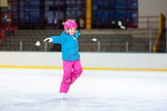 Child skating on indoor ice rink. Kids skate stock photos