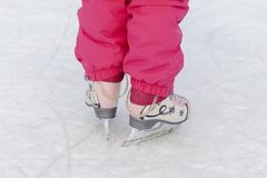 Child skating on the rink stock images