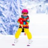 Child on ski lift Royalty Free Stock Photography