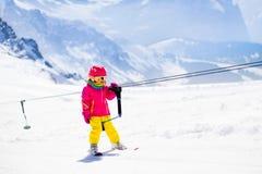 Child on ski lift Royalty Free Stock Images