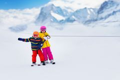 Child on ski lift. Kids skiing stock images