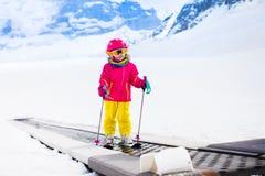 Child on ski lift Stock Image