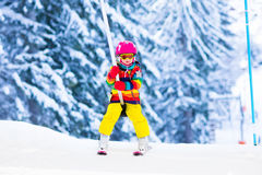 Child on ski lift in snow sport school in winter mountains Royalty Free Stock Image