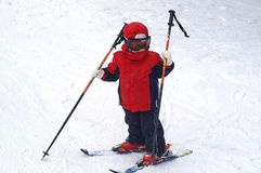 Child ski - poles. Two and a half year old girl enjoying her first skiing experience Stock Photography