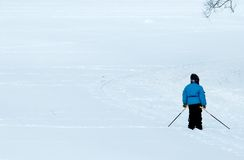 The child on a ski track. The kid has become puzzled: where further to go Royalty Free Stock Photography