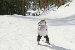 Child skiing downhill Royalty Free Stock Image
