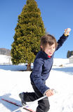 Child skiing falls with cross-country skis Royalty Free Stock Photography