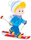 Child skiing. Little boy or girl walking on skis Royalty Free Stock Image