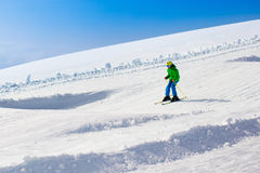 Child skiing in the mountains Stock Photography