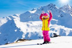Ski and snow fun. Kids skiing. Child winter sport. Royalty Free Stock Images