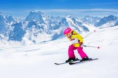 Ski and snow fun. Kids skiing. Child winter sport. Stock Photo