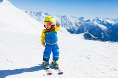 Kids winter snow sport. Children ski. Family skiing. Child skiing in the mountains. Kid in ski school. Winter sport for kids. Family Christmas vacation in the Stock Photography