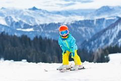 Kids winter snow sport. Children ski. Family skiing. Child skiing in the mountains. Kid in ski school. Winter sport for kids. Family Christmas vacation in the stock photos
