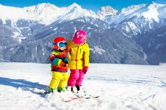 Kids winter snow sport. Children ski. Family skiing. Stock Photos