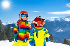 Kids winter snow sport. Children ski. Family skiing. Child skiing in the mountains. Kid in ski school. Winter sport for kids. Family Christmas vacation in the royalty free stock images