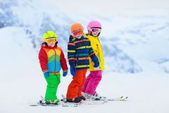 Ski and snow winter fun for kids. Children skiing. Child skiing in the mountains. Kid in ski school. Winter sport for kids. Family Christmas vacation in the Alps stock photography
