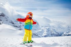 Ski and snow winter fun for kids. Children skiing. Child skiing in the mountains. Kid in ski school. Winter sport for kids. Family Christmas vacation in the Alps royalty free stock photography
