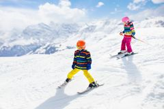 Ski and snow winter fun for kids. Children skiing. Child skiing in the mountains. Kid in ski school. Winter sport for kids. Family Christmas vacation in the Alps royalty free stock image