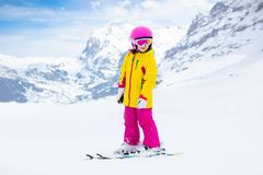 Kids ski. Winter family snow sport. Child skiing. Child skiing in the mountains. Kid in ski school. Winter sport for kids. Family Christmas vacation in the Alps stock images