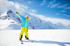 Child skiing in the mountains. Kid in ski school. Winter sport for kids. Family Christmas vacation in the Alps. Children learn. Downhill skiing. Alpine ski stock photos