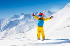 Kids winter snow sport. Children ski. Family skiing. Child skiing in the mountains. Kid in ski school. Winter sport for kids. Family Christmas vacation in the royalty free stock photography