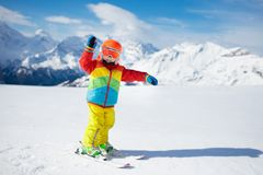 Child skiing in the mountains. Kid in ski school. Winter sport for kids. Family Christmas vacation in the Alps. Children learn. Downhill skiing. Alpine ski royalty free stock photos