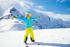 Ski and snow winter fun for kids. Children skiing. Child skiing in the mountains. Kid in ski school. Winter sport for kids. Family Christmas vacation in the Alps royalty free stock photo