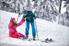 Child skiing in the mountains. Winter sport for kids. Family vac stock photo