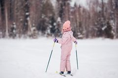 Child skiing in the mountains. Winter sport for kids. Little girl skiing in the mountains. Winter sport for kids royalty free stock image