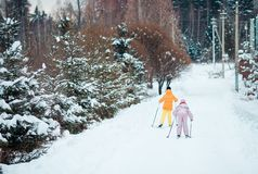 Child skiing in the mountains. Winter sport for kids. Little girls skiing together outdoors on winter day. Winter sport for kids stock photos