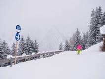 Child skiing on narrow piste royalty free stock image