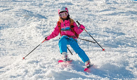 Child skiing in sharp cornering Stock Photography