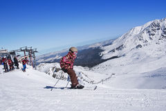 Child with the skis at Tatra mountains Royalty Free Stock Images