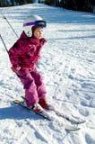 Child slalom. Beautiful girl on slalom skiing Royalty Free Stock Image
