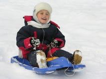 Child on sled Stock Images
