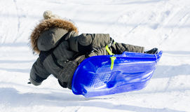 Child on a sled Stock Image