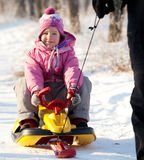 Child on a sled Stock Photography
