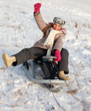 Child on sled Stock Images