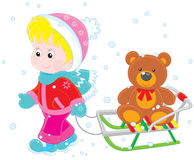 Child with a sled Royalty Free Stock Photos