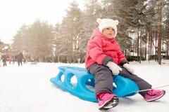 Child on sled royalty free stock image
