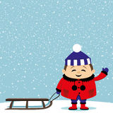 Child and sled on winter background. Royalty Free Stock Image