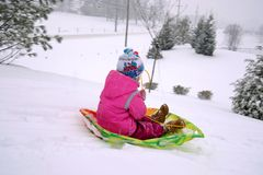 Child sledding. Winter time royalty free stock images