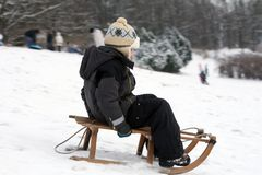 Child sledding - winter fun Stock Photography