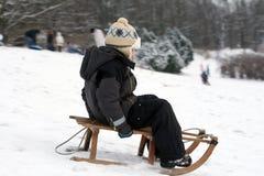 Child sledding - winter fun Stock Photography